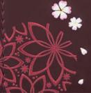 べっぴんさんの手まり柄の刺繍とさくら柄の刺繍
